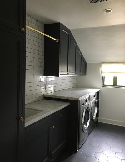 Laundry cabinets painted with waterbourne lacquer finish.