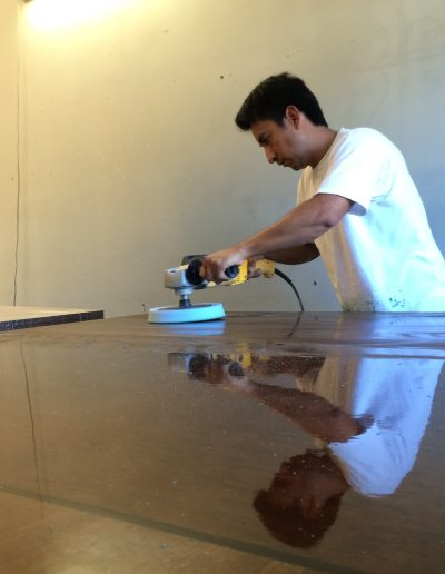 Polishing a finished table top.