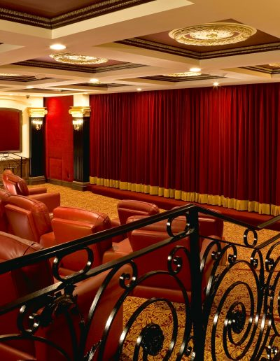 A private theatre finishes: black satin lacquer and stained finishes, gold details.