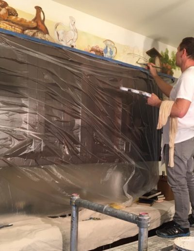 Painting a trompe l'oeil mural above kitchen cabinets