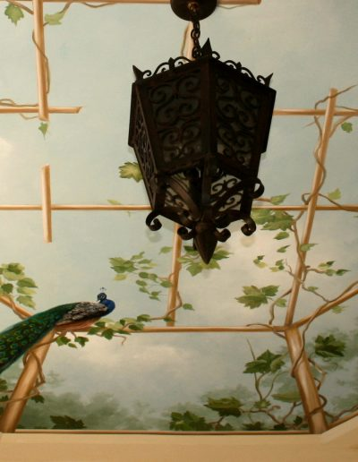 Mural trellis with greenery and birds painted on ceiling