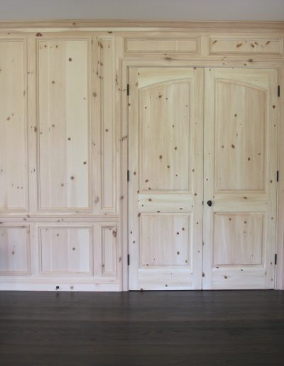 Woodgrain Faux Pine Doors were matched to paneling