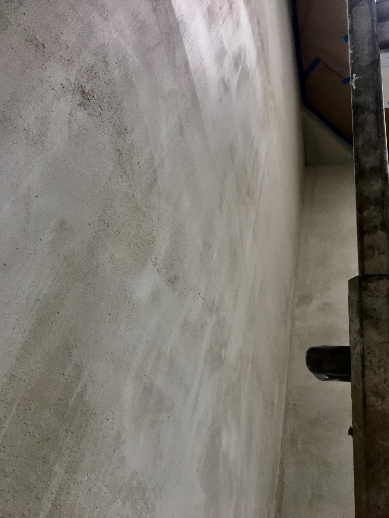 Cement based plaster was applied to the walls